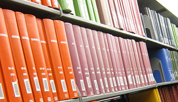 scholarly journals on a library shelf